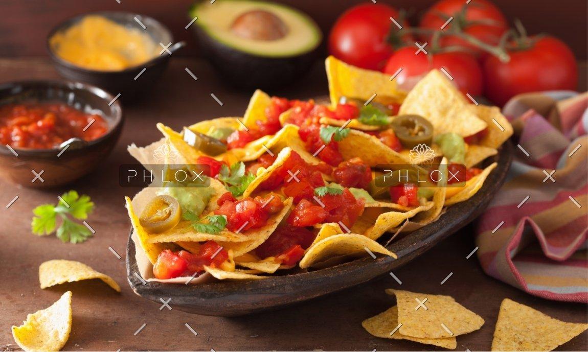 demo-attachment-1166-nachos-loaded-with-salsa-guacamole-cheese-and-P7GUFN7
